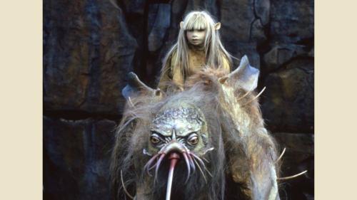Kira with Fizzgig riding atop a Landstrider